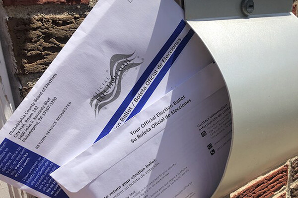 Sealed official mail-in ballot in an open mailbox
