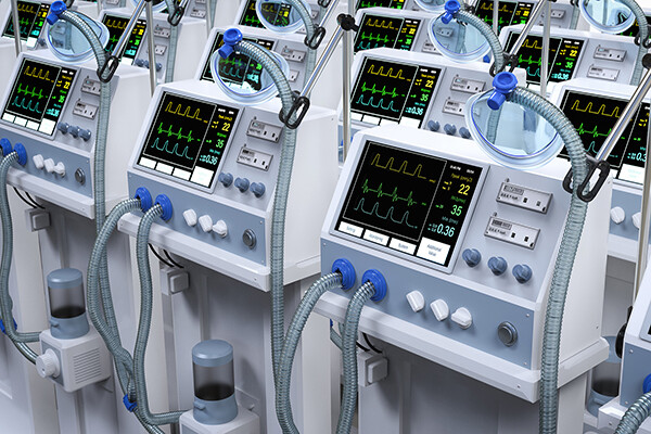 Rows of hospital-grade ventilator machines