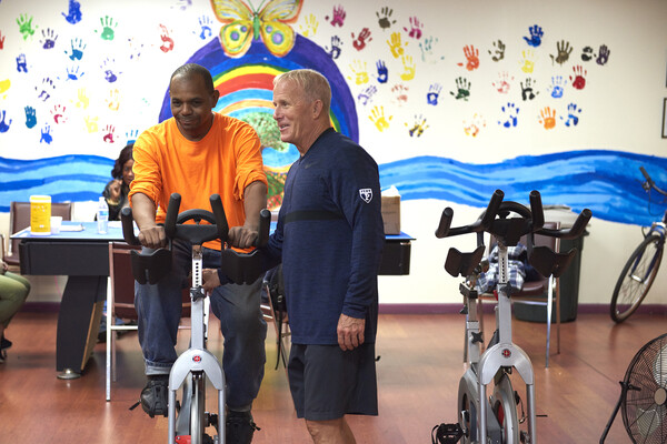 patient working out on a stationary bike