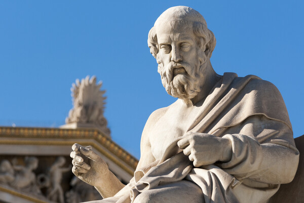 Statue of Plato against blue sky