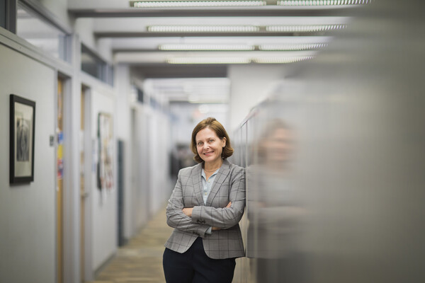 Graduate School of Education professor Sigal Ben-Porath poses in a hallway with her arms folded.