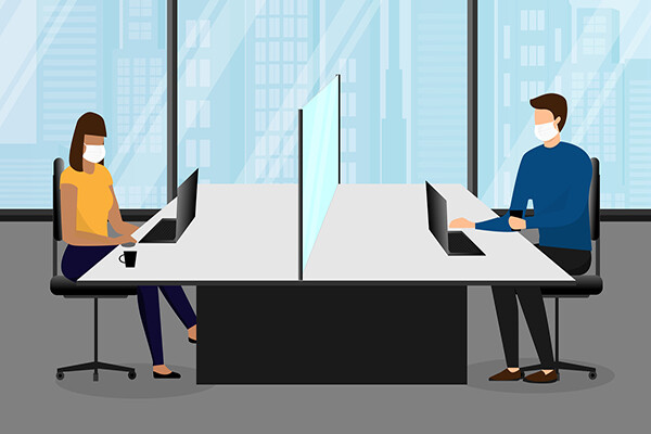 Illustration of two people in an office using a large shared table divided by a glass partition, each wearing face masks while sitting at their laptops.