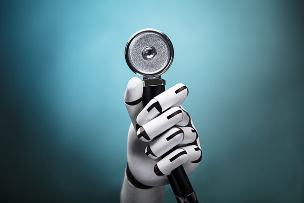 Robotic hand holding a stethoscope.