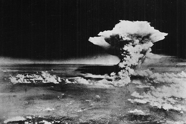 Mushroom cloud rises over Hiroshima after the American atomic bombing in 1945