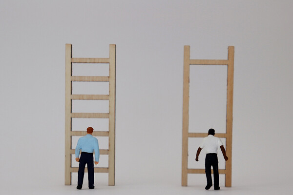 white man in front of ladder next to Black man in front of ladder missing rungs