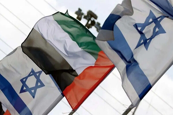 Two flags of Israel flying alongside one flag of the United Arab Emirates.