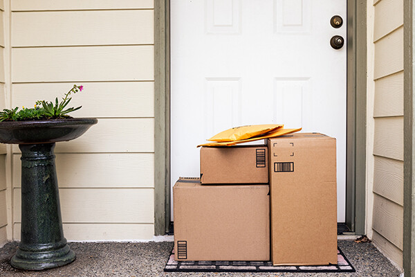 picture of delivery boxes and packages stacked at a residential door