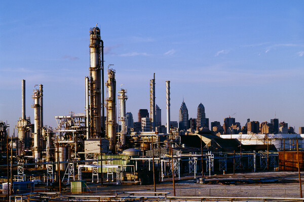 the philadelphia energy solutions refinery with the philadelphia skyline in the background