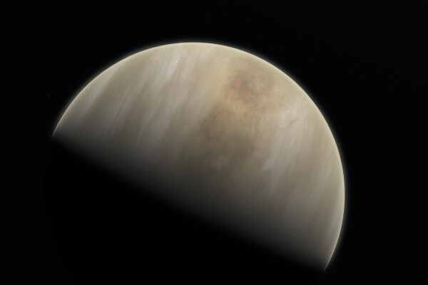 an artists impression of venus, shown half in shadow with a cream and tan colored atmosphere