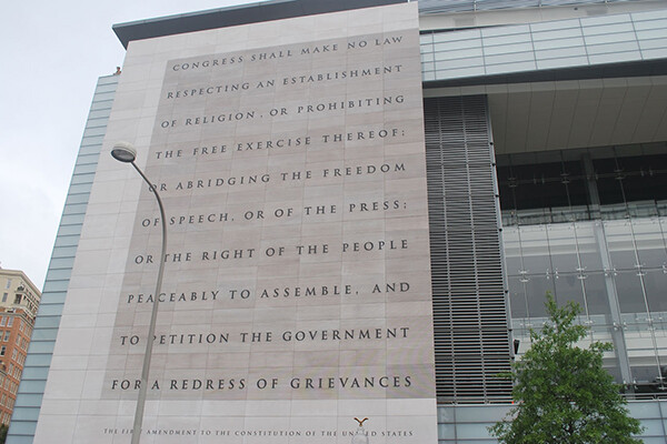 Text of the first amendment displayed on the outer wall of a building.