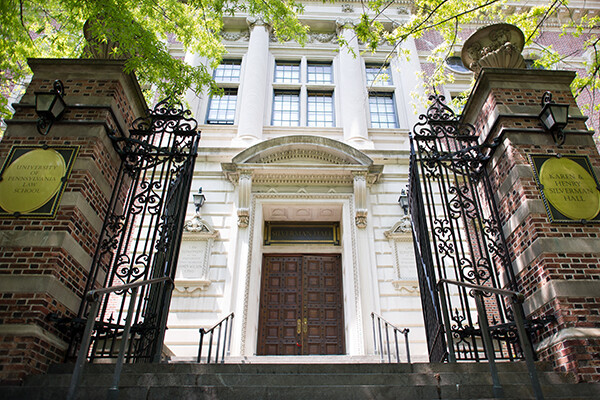 Front gate leading to steps and entrance to Penn Law building on campus.