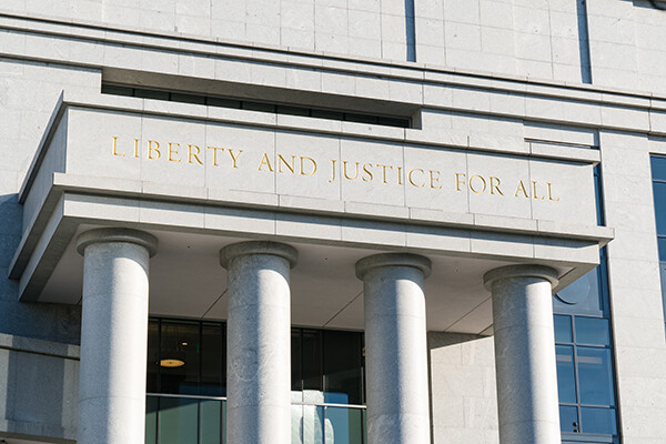 Liberty and Justice for All Sign above the entrance to a Public Defender Office.