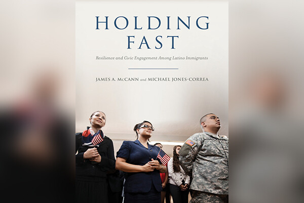 Book cover shows three people, one on the left holding a flag, one in the middle wearing glasses and one on the right wearing U.S. military fatigues.