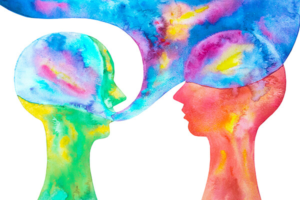 watercolor of two heads in profile with a large dialogue box coming from one figure like a cloud over the other head in bright colors