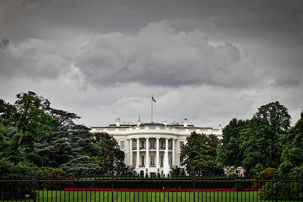 White House seen with stormy clouds overhead.