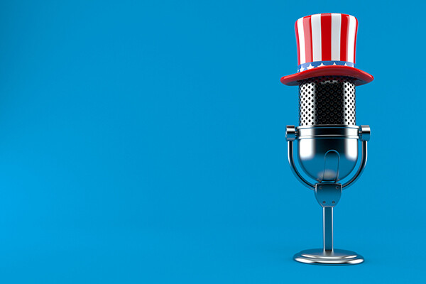 Radio microphone with patriotic hat on top.