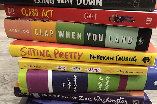 Stack of YA books chosen by the Penn GSE team for its best books of 2020 list.