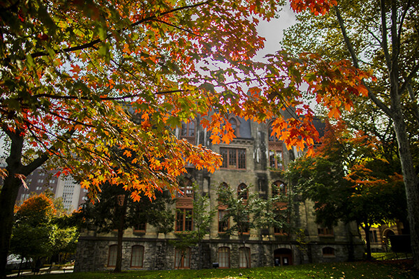 College Hall in daylight in autumn surrounded by fall foliage.