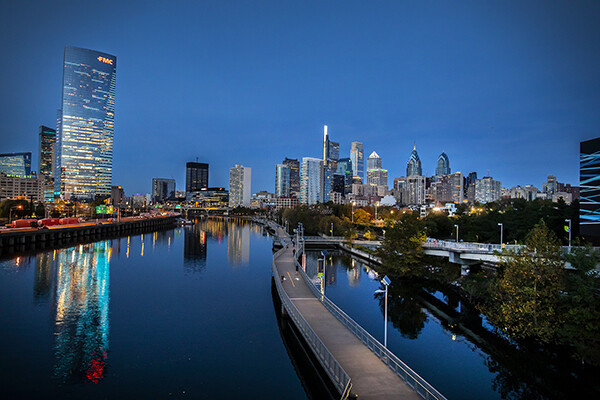 View of Philadelphia skyline from the Schuylkill River at dusk.