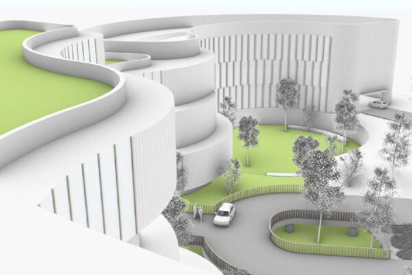 an architectural rendering of a curved hospital entrance with grass and trees