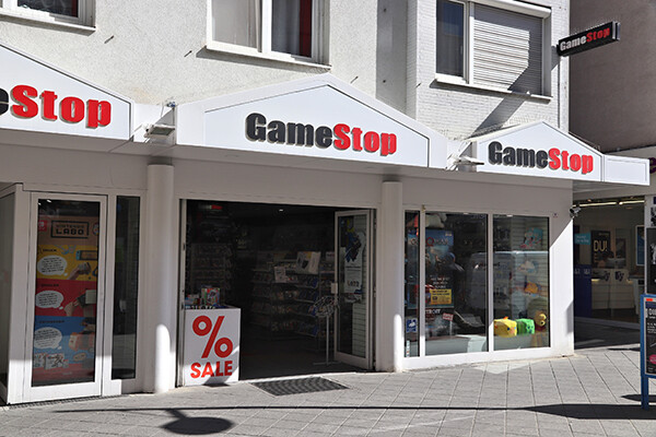 Outside entrance of a GameStop storefront in daylight.