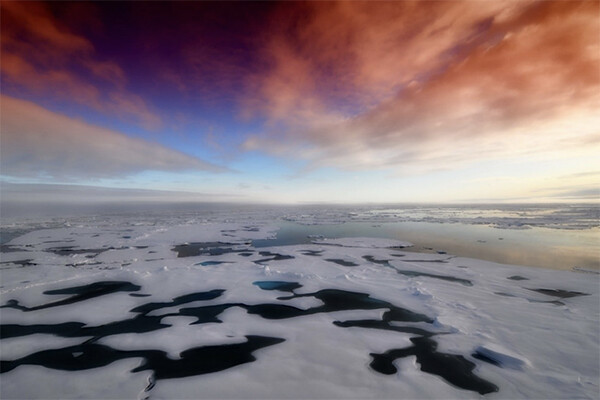 Colorful sky and melting arctic sea ice.