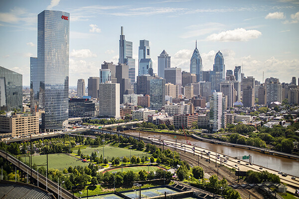 View of Philadelphia skyline with Penn Park in foreground