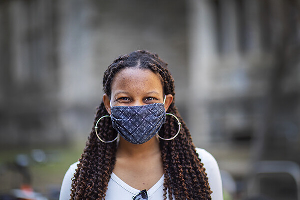 Person smiling while wearing a face mask on Penn's campus