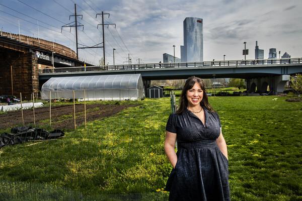 Nina Morris against the backdrop of an urban farm