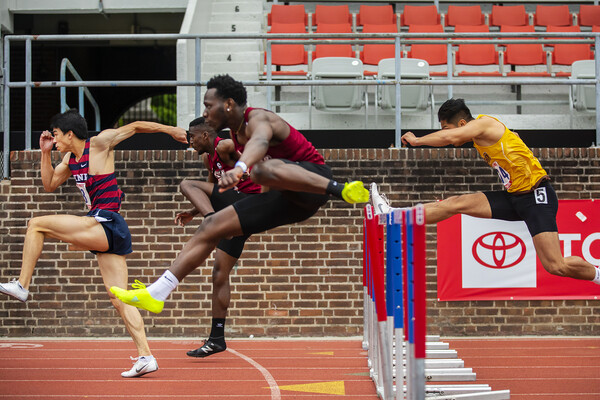 Runners jump over the hurdles at the Philadelphia Metropolitan Collegiate Invitational at Franklin Field on April 24.