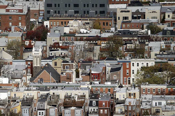 Aerial view of several blocks of rowhouses in Philadelphia.