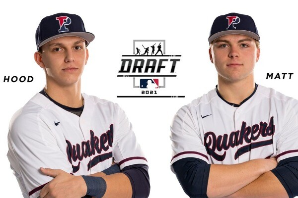 Wearing their white Penn jerseys, Josh Hood, left, and Peter Matt stand with their arms folded, against a white background.