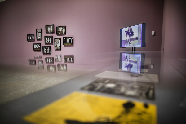 Video screen and photographs hung on a wall